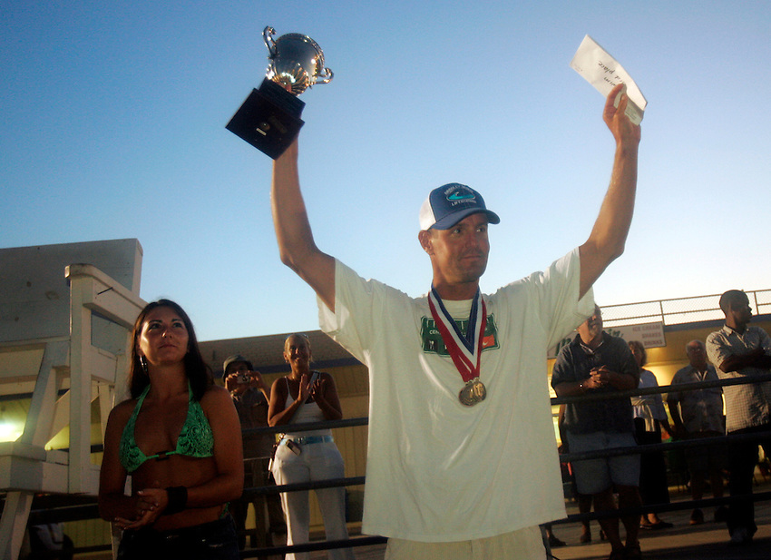 Top overall point scorer Matt Nunnally from Bradley Beach celebrates his victory during the awards ceremony at the First Annual Asbury Park Beach Bar Lifeguard Competition held at the 3rd Avenue beach in Asbury Park.  ASBURY PARK, NJ  8/4/07  8:21:47 PM  PHOTO BY ANDREW MILLS
