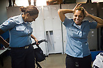 UPP officers Danielle Devino, left, and Elaine Soares Concei&ccedil;&aacute;o, right, prepare for their shift, in Complexo do Caju, Rio de Janeiro, Brazil, on Friday May 10, 2013.<br /> <br /> In the early hours of Sunday, March 3, 2013, about 1,400 Brazilian security forces occupied 13 communities during a joint public security operation to install a Pacifying Police Unit (UPP) in two Rio de Janeiro favelas, Complexo do Caju and Barreira do Vasco. Elite police units backed by armored military vehicles and helicopters invaded the neighborhood in an on-going policing program aimed to drive violent and heavily armed drug gangs out of Rio's poor communities, where the traffickers have ruled for decades. For the community of Caju, that is ADA (Amigos de Amigos) and CV (Comando Vermelho).