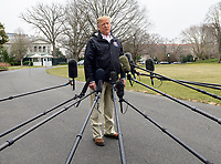 United States President Donald J. Trump speaks to the press as he departs the White House in Washington, DC on Friday, March 8, 2019.  The President will travel to Alabama to see the damage from the tornados earlier in the week before continuing to Florida to spend the weekend at his Mar-a-Lago resort.<br /> CAP/MPI/RS<br /> &copy;RS/MPI/Capital Pictures