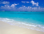Anguilla, BWI<br /> the subtle pinks of dusk reflect in the sand and Caribbean waters on the beach of Shoal Bay East
