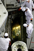 Technicians fetch highly enriched uranium assemblies from a water pool under the nuclear reactor at the Institute of Nuclear Physics in Almaty, Kazakhstan. .The removal of Kazakhstan's highly enriched uranium (HEU) is part of the U.S. Global Threat Reduction Initiative (GTRI), where Igor Bolshinsky and Kelly Cummins work, that tries to secure nuclear material around the world to prevent their misuse by terrorists and rogue states.