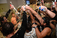 Jacksonville Suns manager Andy Barkett (17) gets doused by his players after game three of the Southern League Championship Series against the Chattanooga Lookouts on September 12, 2014 at Bragan Field in Jacksonville, Florida.  Jacksonville defeated Chattanooga 6-1 to sweep three games to none.  (Mike Janes/Four Seam Images)