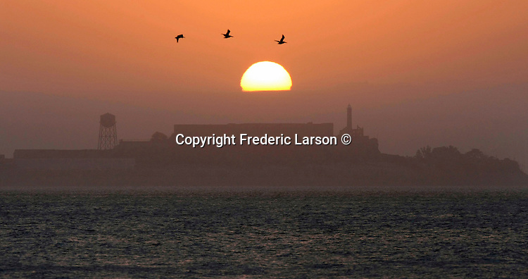 The sun rises over the Alcatraz Island in San Francisco, California.
