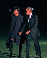 United States President Barack Obama and first lady Michelle Obama walk from Marine One on the South Lawn of the White House in Washington, DC to the Residence after a day of campaigning around the country for Hillary Clinton, the Democratic Party nominee for President on November 7, 2016.<br /> Credit: Dennis Brack / Pool via CNP /MediaPunch