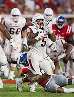 NWA Democrat-Gazette/BEN GOFF @NWABENGOFF<br /> Rakeem Boyd, Arkansas running back, tries to break the tackle of Jacquez Jones (10) Ole Miss linebacker, in the third quarter Saturday, Sept. 7, 2019, at Vaught-Hemingway Stadium in Oxford, Miss.