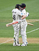 29th November 2019, Hamilton, New Zealand;  New Zealand opening batsman Tom Latham celebrates his century with Henry Nicholls on day 1 of the 2nd international cricket test match between New Zealand and England at Seddon Park, Hamilton, New Zealand. Friday 29 November 2019