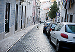 Alfama is the oldest district sits on the hill in Lisbon, Portugal. Consisting many significant historical attractions with many Fedo bars and restaurants, Alfama attract many tourists.  Walking around and getting lost in narrow streets and allies invite visitors to feel and discover old Lisbon life style.
