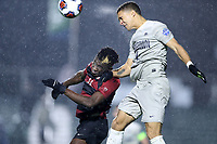 CARY, NC - DECEMBER 13: Rio Hope-Gund #2 of Georgetown University heads the ball over Ousseni Bouda #11 of Stanford University during a game between Stanford and Georgetown at Sahlen's Stadium at WakeMed Soccer Park on December 13, 2019 in Cary, North Carolina.