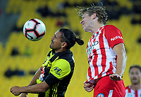 David Williams is beaten to a header by Harrison Delbridge (right) during the A-League football match between Wellington Phoenix and Melbourne City FC at Westpac Stadium in Wellington, New Zealand on Sunday, 21 April 2019. Photo: Dave Lintott / lintottphoto.co.nz