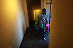 Jack Word carries his kid's luggage to his vehicle after he and his wife Malinda and their three children, Teyerah,12, Jack,7, and Trynique,3, spent the night at a homeless shelter in Portland.