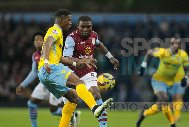 Wilfried Zaha off Palace holds off a challenge from Jores Okore of Aston Villa - Wilfried Zaha of Palace Barclays Premiership Football - Aston Villa v Crystal Palace - Villa Park  Birmingham - Season 14/15 - 01/01/2015 <br /> Photo: Malcolm Couzens/Sportimage