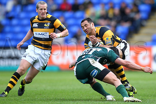 03.04.2011 Wasps Centre Riki Flutey in possession but being tackled by London Irish Fly Half Daniel Bowden Aviva Premiership Rugby from Madejski Stadium. London Irish v London Wasps.