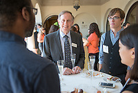 Graduating seniors in the class of 2016 gather for a reception with President Jonathan Veitch at the Samuelson Alumni Center.<br />