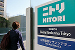 A woman walks past a Nitori signboard on display outside the new Nitori department store in Shinjuku's Takashimaya Times Square on December 9, 2016, Tokyo, Japan. Nitori Holdings opened the new furniture and home accessory store in the South Hall of Tokyo's Takashimaya Times Square commercial complex on December 1st. The company plans to increase the number of its stores to 2000 overseas and 1000 in Japan by 2032. (Photo by Rodrigo Reyes Marin/AFLO)