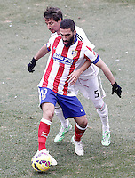 Atletico de Madrid's Arda Turan (l) and Real Madrid's Fabio Coentrao during La Liga match.February 7,2015. (ALTERPHOTOS/Acero) /NORTEphoto.com