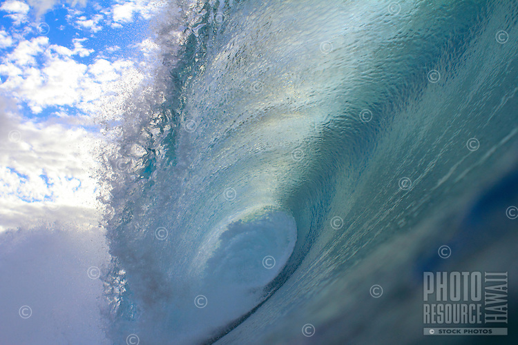Aqua blue wave at Rockpiles on the North Shore of O'ahu.