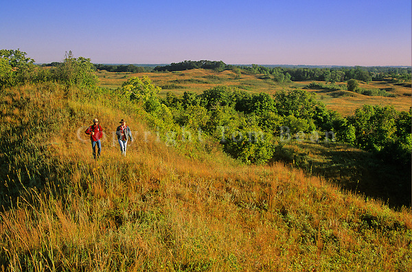 Couple hiking the tallgrass prairie at Sheyenne National Grassland, near Lisbon, North Dakota, AGPix_0080 .