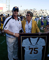 California head coach Jeff Tedford receives 75th victory complement from California Athletic Director Sandy Barbour after winning the game against Presbyterian at AT&T Park in San Francisco on September 17th, 2011.  California defeated Presbyterian, 63-12.