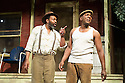 London, UK. 21.06.2013. FENCES, by August Wilson, opens at the Duchess Theatre, in London's West End, following a successful run at Theatre Royal Bath. Lenny Henry takes on the lead role of Troy Maxson in, this production, which is directed by Paulette Randall. Picture shows: Lenny Henry (Troy Maxson) and Colin McFarlane (Jim Bono). Photograph © Jane Hobson.
