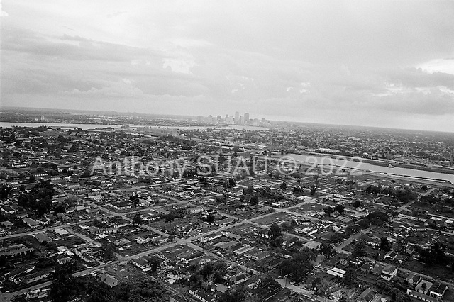 New Orleans, Louisiana.USA.July 31, 2006..Aerials of New Orleans nearly one year after hurricane Katrina hit and the levees broke. Nearly 80% of the city was flooded...Most of the homes in the lower ninth ward remain as they did after the water was drained. A new levee wall was put in place for the current hurricane season. Some of the heavily damaged homes near the levee have been removed...