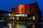 Main Street in the rain, twilight, evening, night, Rockland, Maine, USA, showing the Strand Theater.