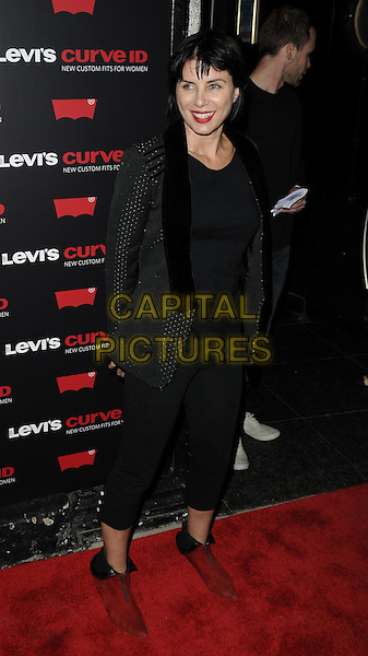 SADIE FROST .The Levi's Curve new denim range launch party, Studio Valbonne nightclub, London, England..September 2nd, 2010.full length black leggings cropped red booties shooboots shoe boots tuxedo jacket top .CAP/CAN.©Can Nguyen/Capital Pictures.