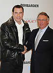 BURBANK, CA - SEPTEMBER 20: John Travolta and Brant Dahlfors attend the Bombardier business aircraft press conference at Hangar 25 at Burbank Airport on September 20, 2011 in Burbank, California.