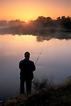 Fisherman at sunrise on bend in the San Joaquin river, Great Grasslands State Park, Merced County, Central Valley, California
