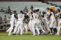 Quad Cities River Bandits Randy Cesar (39) is mobbed by teammates, including Zac Person (21), Myles Straw (4), Christian Correa (9), Kristian Trompiz (3), after a walk off hit during a game against the Bowling Green Hot Rods on July 24, 2016 at Modern Woodmen Park in Davenport, Iowa.  Quad Cities defeated Bowling Green 6-5.  (Mike Janes/Four Seam Images)