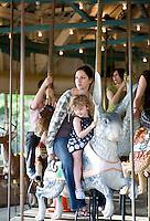 Teri Podolak and Luna Pierson enjoy the carousel at Pullen Park.