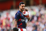 Theo Walcott of Arsenal with child during the English Premier League match at the Emirates Stadium, London. Picture date: May 21st 2017.Picture credit should read: Charlie Forgham-Bailey/Sportimage