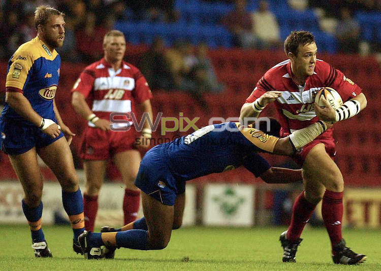 Pix: Oskar Vierod/SWpix.com. Super League Rugby. Wigan v Leeds. 20/09/2002...COPYRIGHT PICTURE>>SIMON WILKINSON>>01943 436649>>..Wigan's Danny Sculthorpe and Leeds Ryan Bailey..