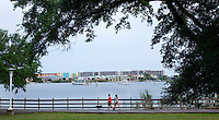 Boats and walkers pass each other at the Landing Park in downtown Fort Walton Beach...COLIN HACKLEY PHOTO
