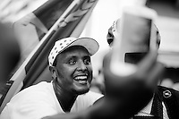 Eritrean fans are ecstatic when Daniel Teklehaimanot (ERI/MTN-Qhubeka) crosses the finish line 7th today and keep chanting and taking pics of their hero straight after the race<br /> <br /> stage 16: Bourg de Péage - Gap (201km)<br /> 2015 Tour de France