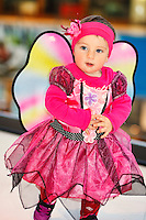 A pretty little girl in fairy costume having fun