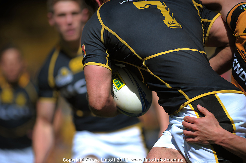 Scott Fuglistaller looks for support during the ITM Cup rugby union match between Wellington Lions and Taranaki at Westpac Stadium, Wellington, New Zealand on Sunday, 14 October 2012. Photo: Dave Lintott / lintottphoto.co.nz