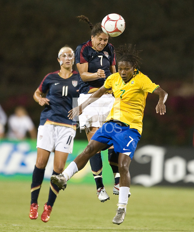 Shannon Boxx wins the ball over Formiga, right, USA over Brazil 1-0, in San Diego, Calif., Wednesday, July 16, 2008.