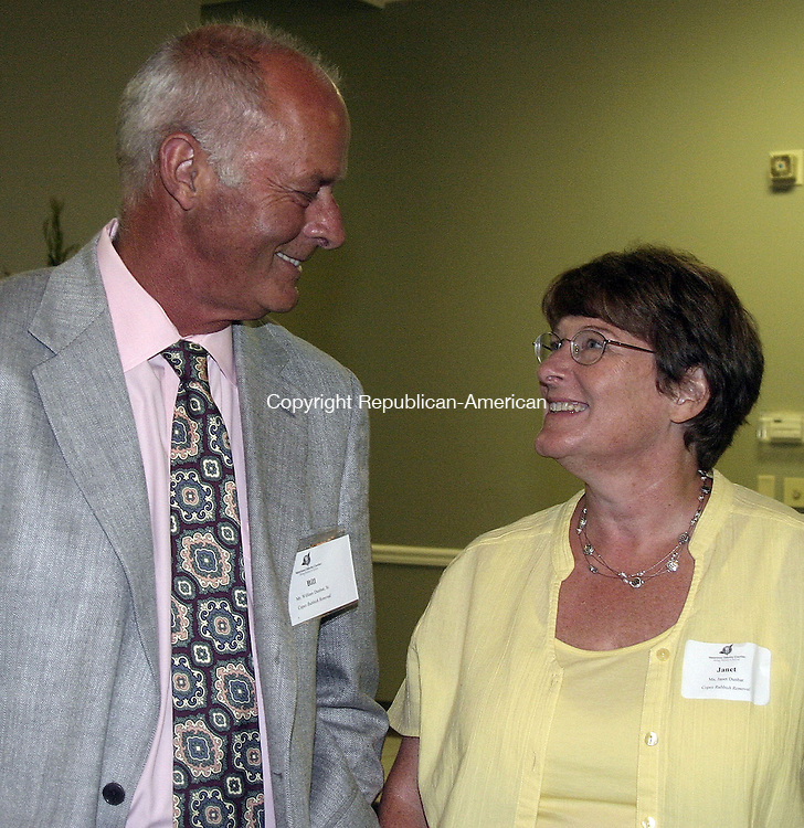 WATERTOWN, CT -26 JUNE 2008 -062608DA02- President and owner of Copes Rubbish Removal, William Dunbar Sr., left, talks with his wife, Janet during the Watertown-Oakville Chamber of Commerce Annual Business Meeting and Luncheon honoring William with the Watertown-Oakville Chamber's 2008 Community Leader of the year award held Thursday at the Grand Oak Villa in Watertown. Darlene Douty/Republican-American