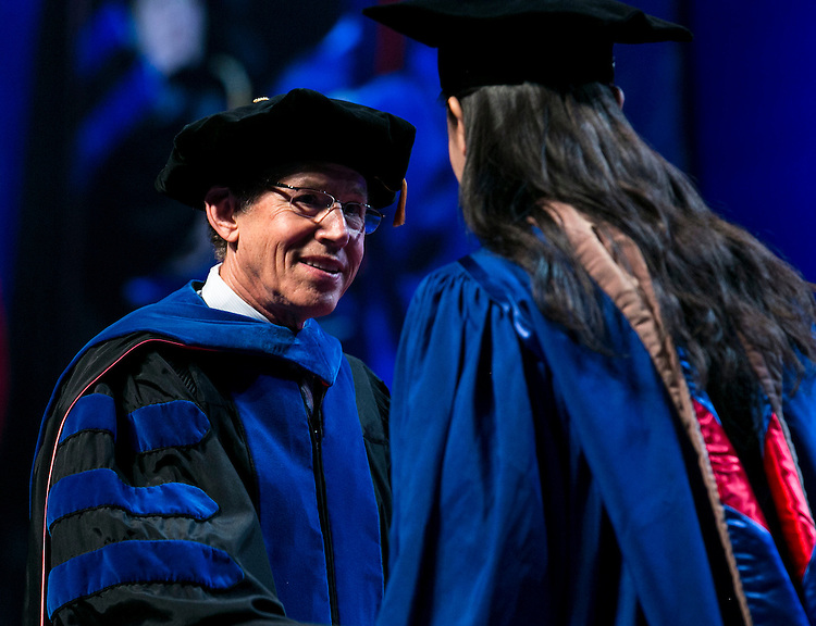 Ray Whittington, dean of the Driehaus College of Business, hands out diplomas to the graduates as the Driehaus College of Business held its commencement ceremony Sunday, June 12, 2016, at the Allstate Arena in Rosemont, IL. Nearly 1,400 students received their degrees. (DePaul University/Jamie Moncrief)Paul University/Jamie Moncrief)