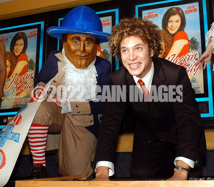 "Justin Guarini, American Idol runner-up and Doylestown native greets fans at an advance screening of the film ""From Justin to Kelly"" after being honored at te Regal Warrington Crossing 22 Theater June 13, 2003 in Warrington, Pennsylvania. (Photo by William Thomas Cain/photodx.com)"