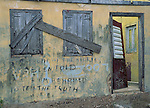 Anguilla, British West Indies  - Caribbean Islands<br /> Graffiti on a wall of an abandoned yellow house