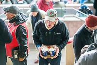 Man Carrying coffee <br /> Re: Behind the Scenes Photographs at the Liberty Stadium ahead of and during the Premier League match between Swansea City and Bournemouth at the Liberty Stadium, Swansea, Wales, UK. Saturday 25 November 2017