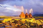 The Fly geyser (hot artesian well), clearing late afternoon summer storm, travertine pool terraces, Black Rock Desert, Nevada