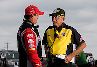 Sept. 1, 2013; Clermont, IN, USA: NHRA top fuel dragster driver Billy Torrence (left) talks with Safety Safari member during qualifying for the US Nationals at Lucas Oil Raceway. Mandatory Credit: Mark J. Rebilas-