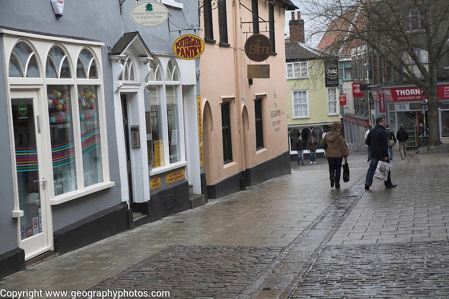 Cobbled shopping street after rain, Norwich, Norfolk, England