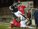 Raith's David Smith is taken out by Deveronvale's Graeme Roger ...