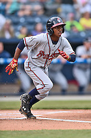 Rome Braves shortstop Ozzy Albies (7) swings at a pitch during a game against the Asheville Tourists on May 15, 2015 in Asheville, North Carolina. The Braves defeated the Tourists 6-0. (Tony Farlow/Four Seam Images)