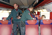 A mobile team of Swiss Gardes Frontière, control the identity of the passengers in the morning TGV Paris-Lausanne, between the station Vallorbe - Lausanne.