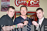 FINE WINE: John Paul Murphy, Erwin Kingston and Oliver Baumann sampling some Chilean wine at the wine tasting night in The Soda Club, Killorglin, in aid of Cystic Fibrosis, last Thursday night..