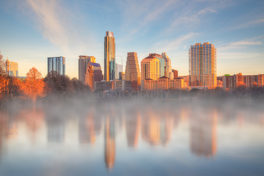 Fog filled the air in late January as the Austin skyline shows its reflection in Lady Bird Lake. This photograph was taken along the boardwalk that skirts the lake and connects the hike and bike path to Zilker Park.